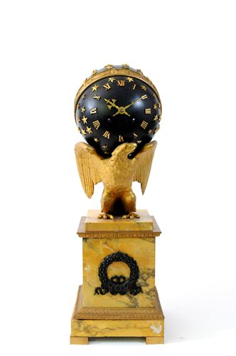 477 - An Empire style ormolu and bronze eagle and globe mantel clock