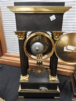 Lot 205-A French ormolu and bronze empire style portico clock