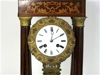 Lot 210-A French rosewood and inlaid portico clock