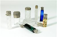 Lot 24-A collection of silver topped scent bottles