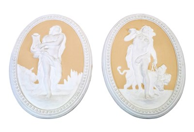 Lot 545-A decorative pair of wall hanging plaster panels
