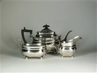 Lot 87-A three piece silver tea service