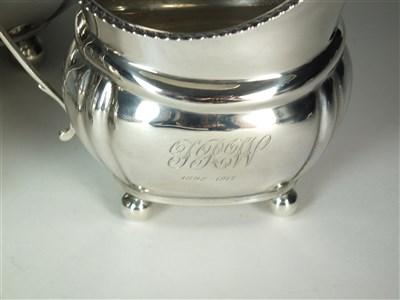 Lot 87-A three piece silver tea service