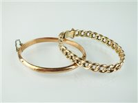 Lot 134-Two 9ct gold bangles