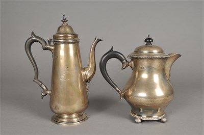 Lot 63-A silver coffee pot and a silver hot water jug