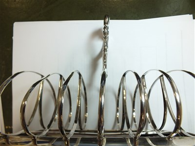 Lot 121-An Exeter silver toast rack