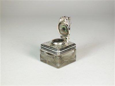 Lot 60-An Irish silver mounted travelling inkwell