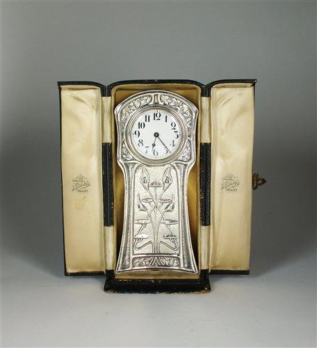 109 - An Art Nouveau silver cased timepiece