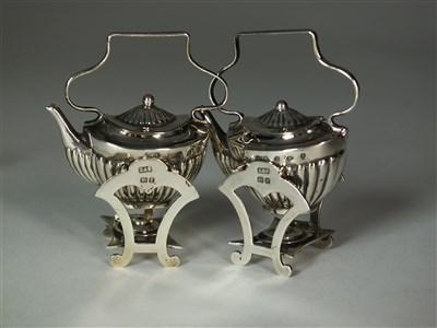 Lot 11 - An Edwardian silver miniature tea service