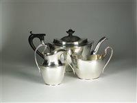 Lot 57-A three piece silver tea service