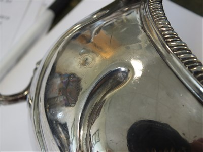 Lot 52-A near pair of Irish silver sauce boats
