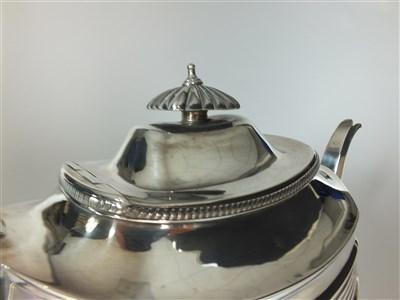Lot 12-A three piece silver tea service