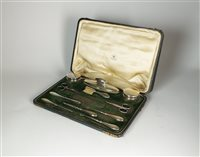 Lot 82-A cased silver mounted travelling vanity set