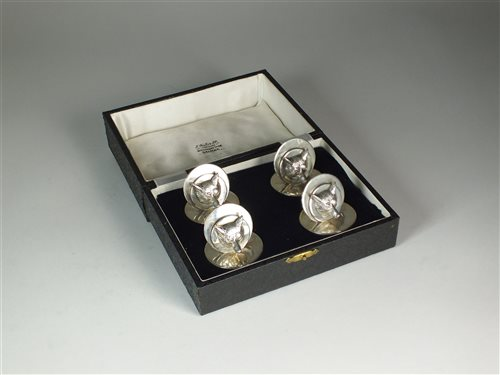 Lot 35-A cased set of four silver menu holders