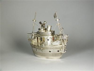 Lot 68-A white metal model of a ship