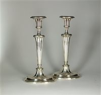 Lot 106-A pair of silver mounted candlesticks