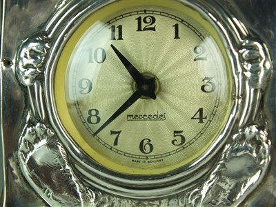 Lot 24 - A silver mounted timepiece