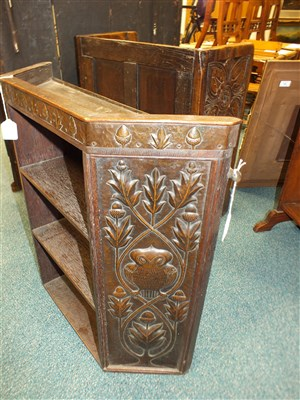 Lot 898-An English school copper clad oak Arts and Crafts bookcase