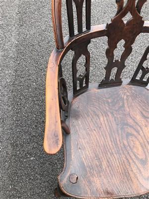 Lot 239-An unusual 18th century vernacular gothic Windsor armchair