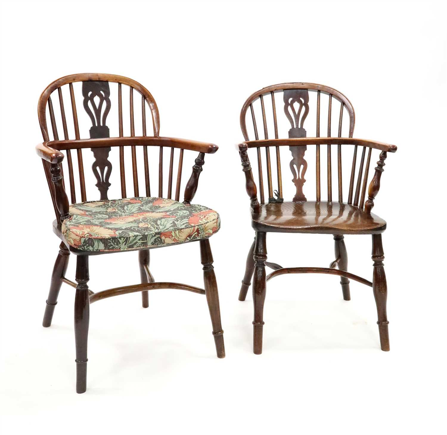 247 - A closely associated set of four 18th century Windsor stick back kitchen chairs