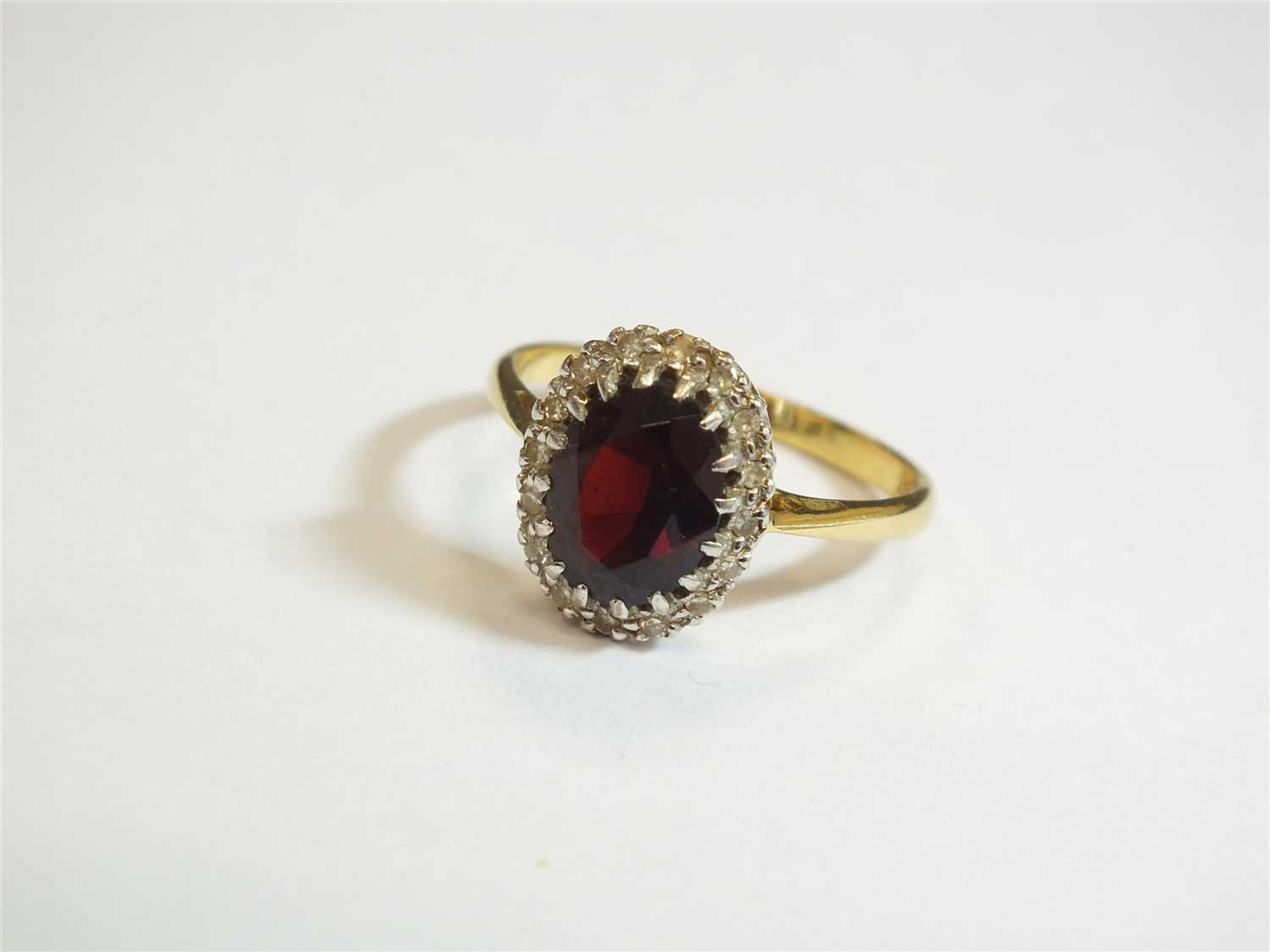 Lot 16-A garnet and diamond cluster ring