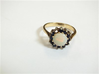 Lot 18-Two rings and a pair of earrings