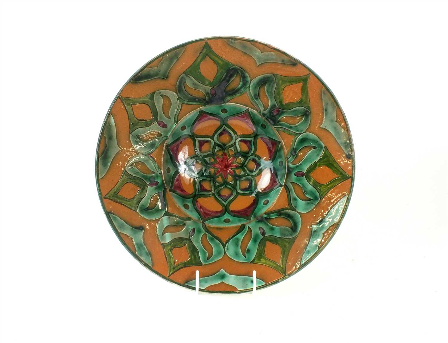 Lot 91-A Della Robbia Art Pottery charger by Liz Wilkins