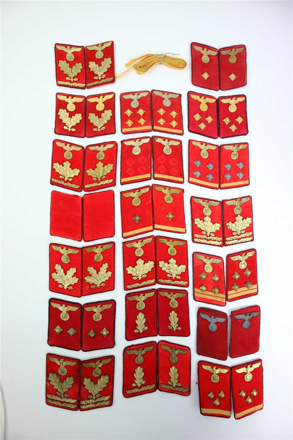 495 - Twenty sets of German Third Reich NSDAP Gau-level collar tabs