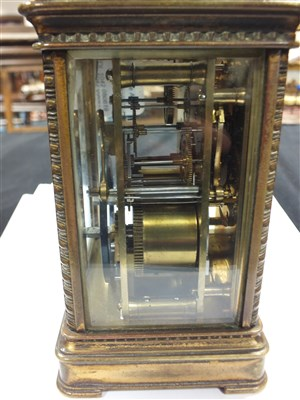 Lot 702-A large Edwardian brass cased carriage clock