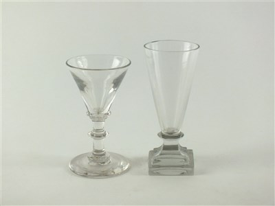 Lot 133-An unusual 18th century dwarf ale firing glass and a 19th century wine glass