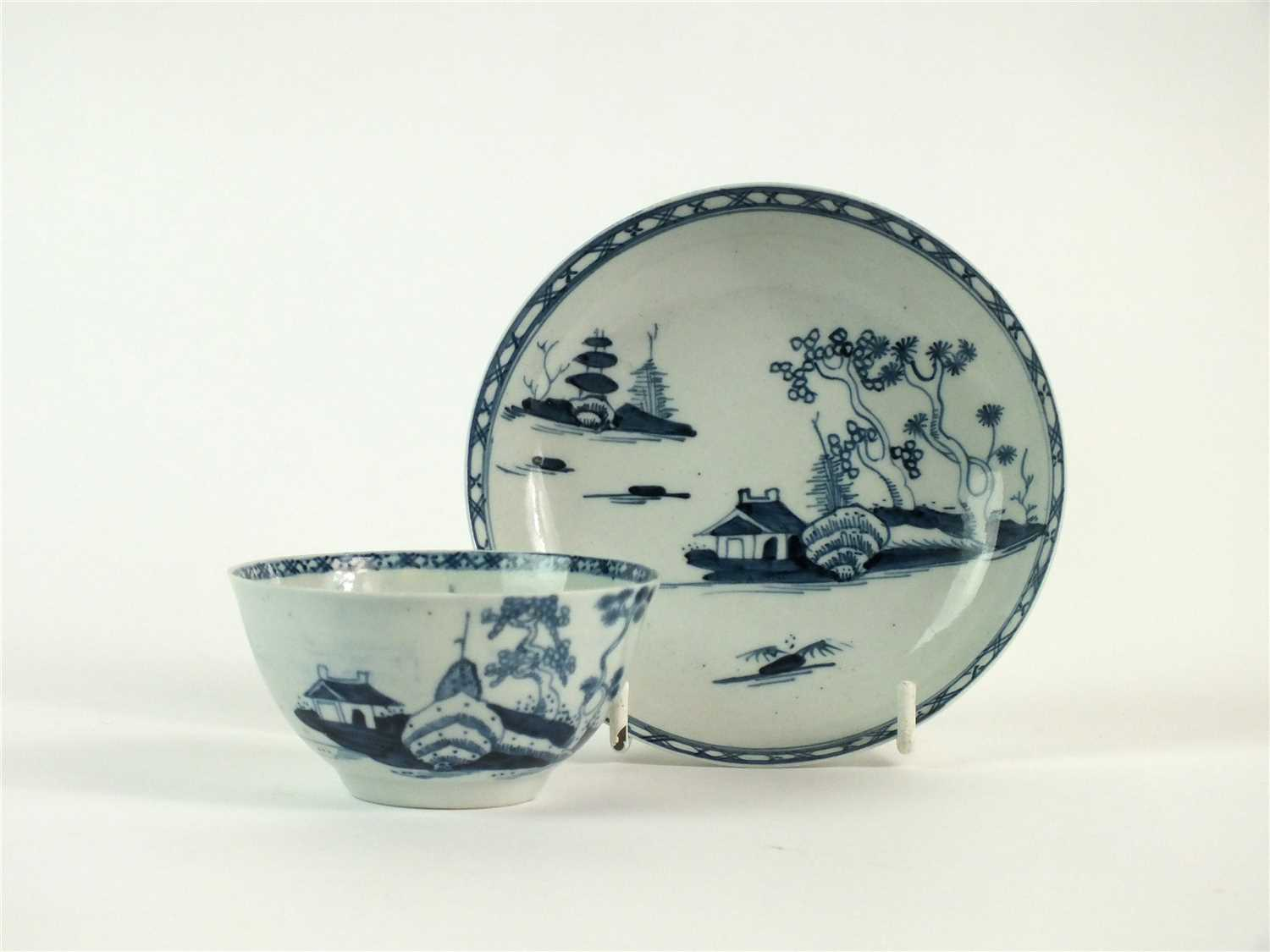Lot 41-A Richard Chaffers, Liverpool 'Cannonball' tea bowl and saucer