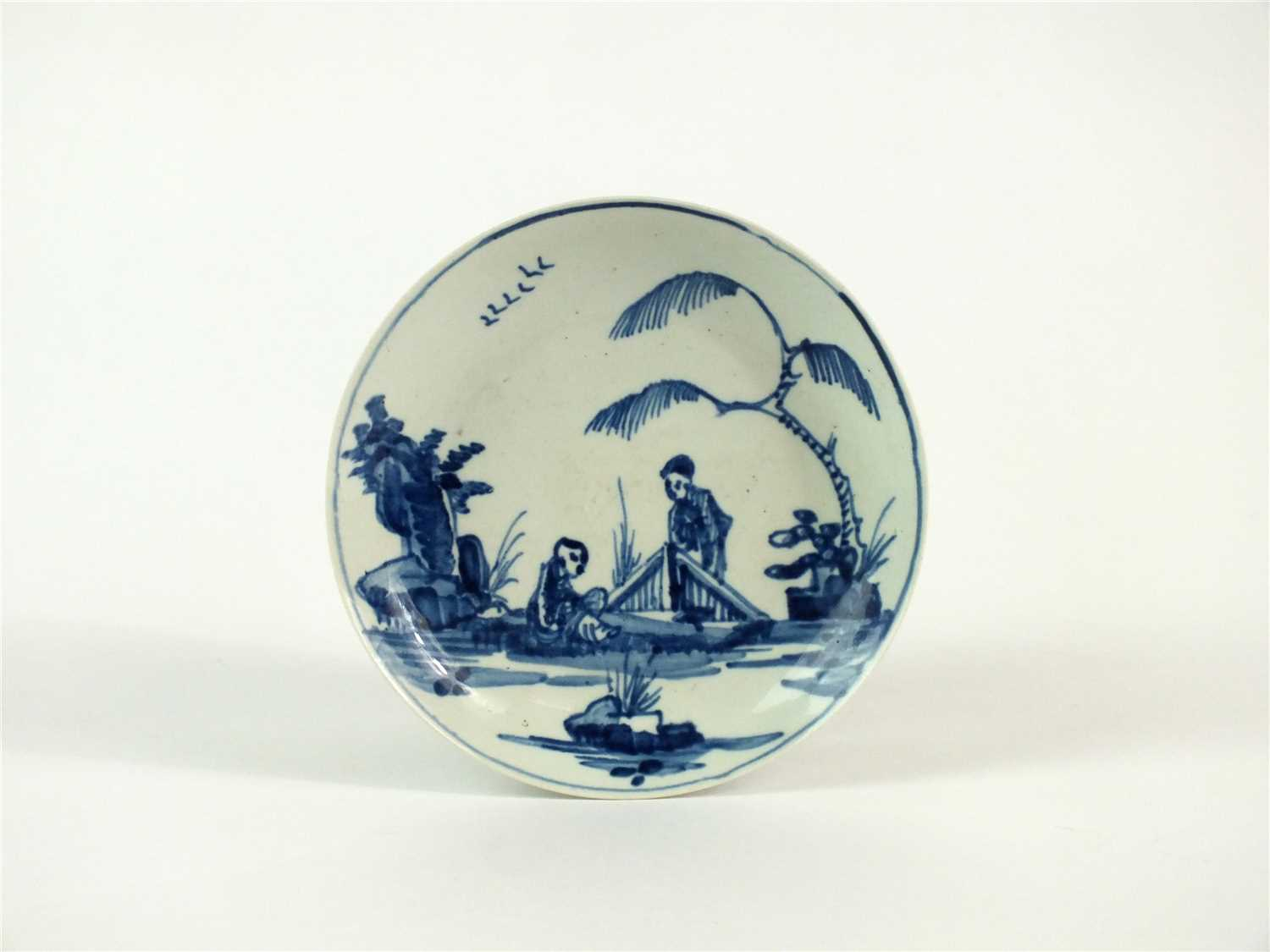 Lot 50 - A Vauxhall porcelain blue and white saucer