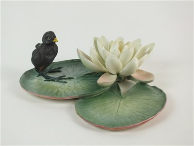 Lot 66-A Royal Worcester model of a Moorhen Chick and a Water Lily