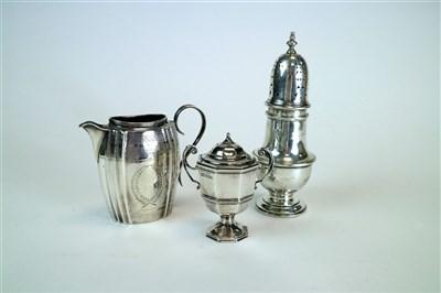 Lot 128-A silver cream jug, sugar caster and trophy cup