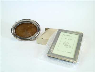 Lot 135-Two silver mounted frames