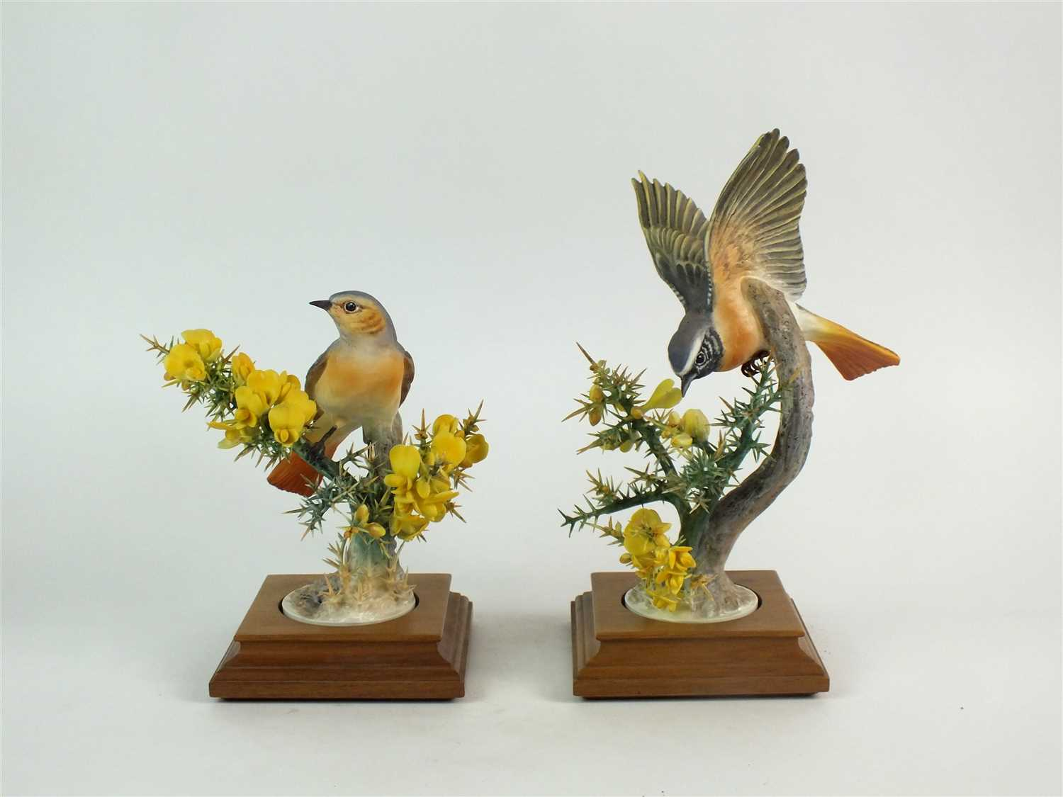 Lot 74-A pair of Royal Worcester models of Redstarts and Gorse