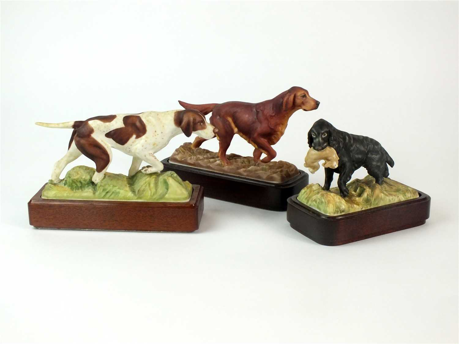 Lot 82-Three Royal Worcester models of Sporting Dogs