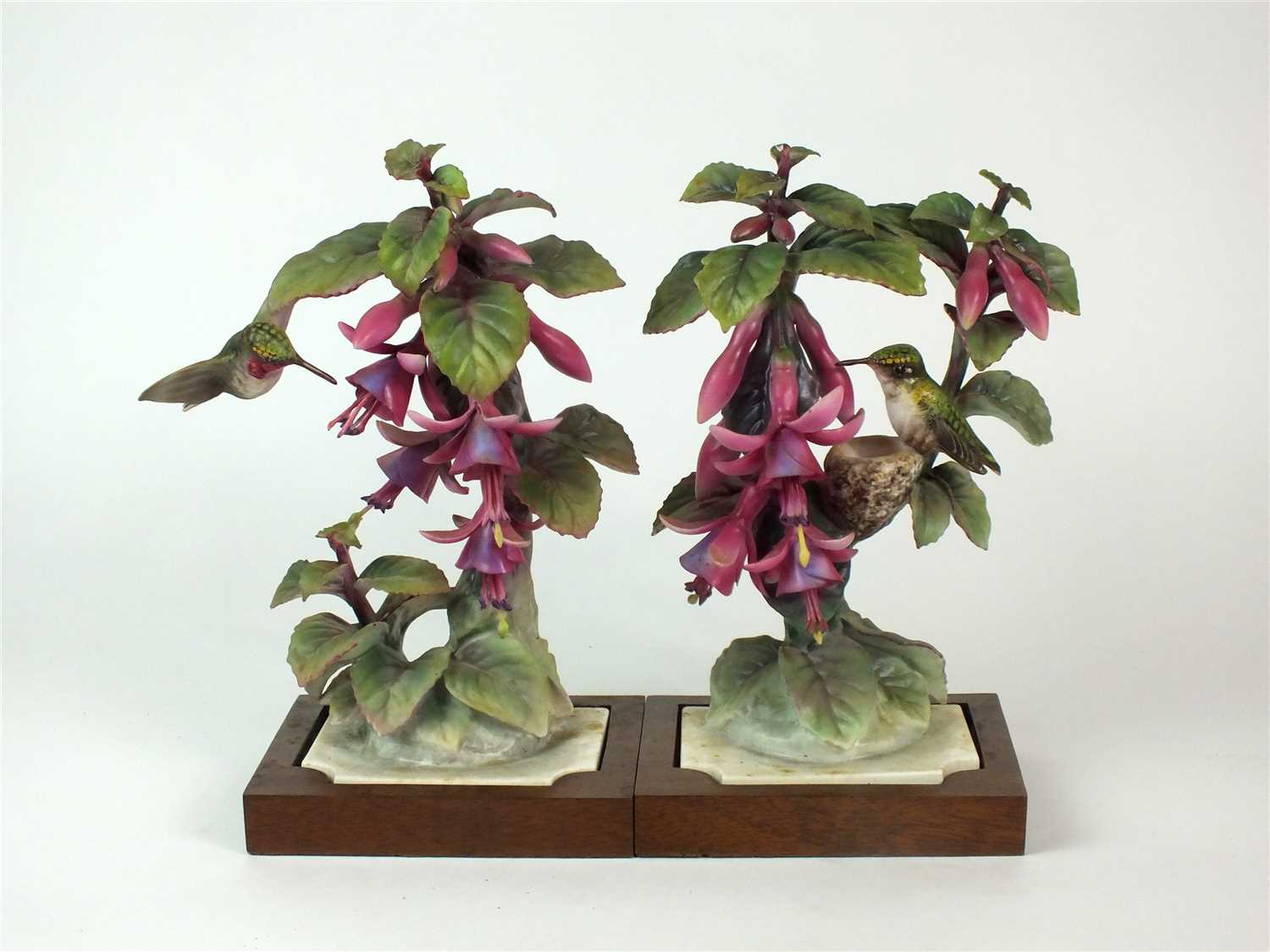 Lot 86 - A pair of Royal Worcester models of Ruby-Throated Hummingbirds on Fuschia