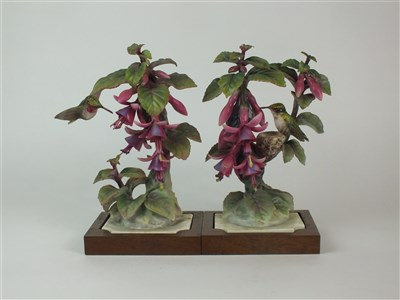Lot 86-A pair of Royal Worcester models of Ruby-Throated Hummingbirds on Fuschia