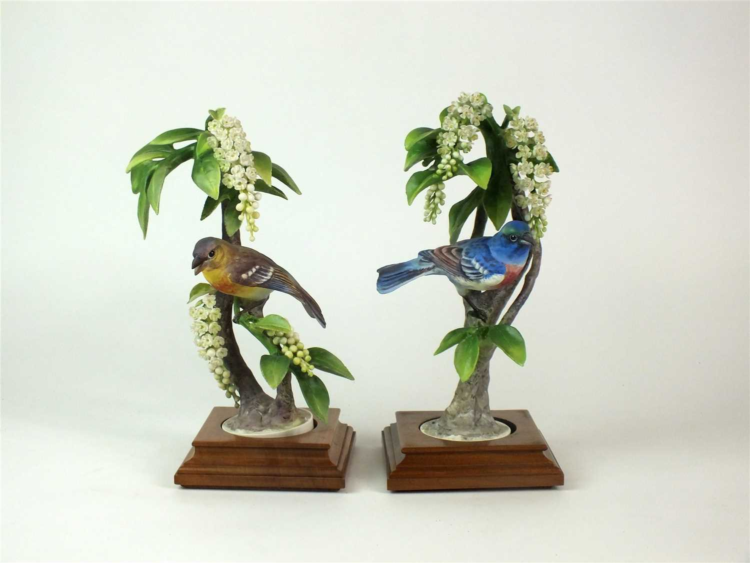 Lot 88-A pair of Royal Worcester models of Lazuli Bunting on Choke Cherry