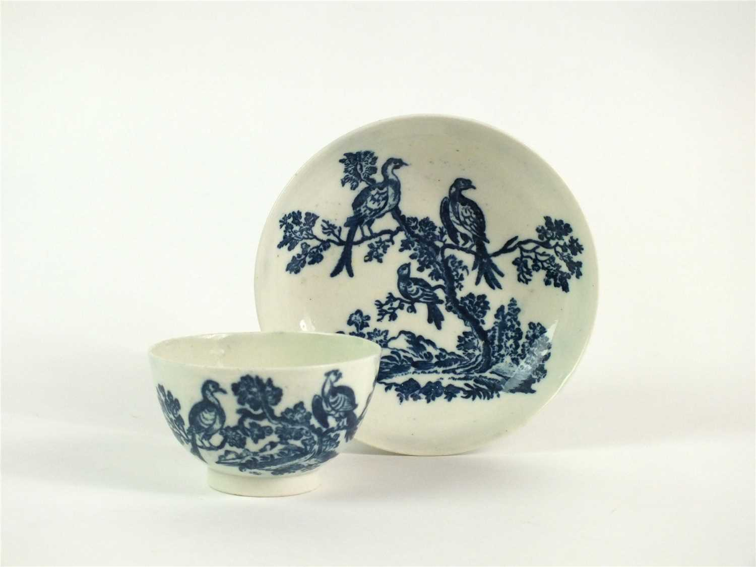 Lot 52 - A Caughley Birds in Branches tea bowl and saucer
