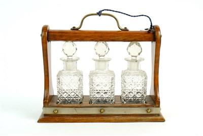 Lot 172-A Victorian miniature oak three decanter tantalus