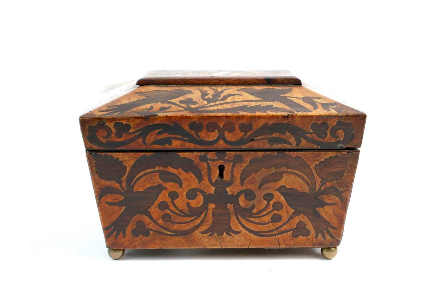 Lot 185-An early 19th century burr walnut veneered sarcophocus shaped tea caddy