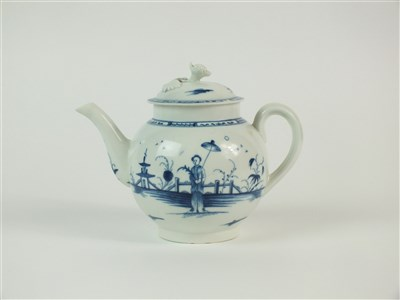Lot 5-A rare Caughley 'Girl with Parasol' teapot and cover