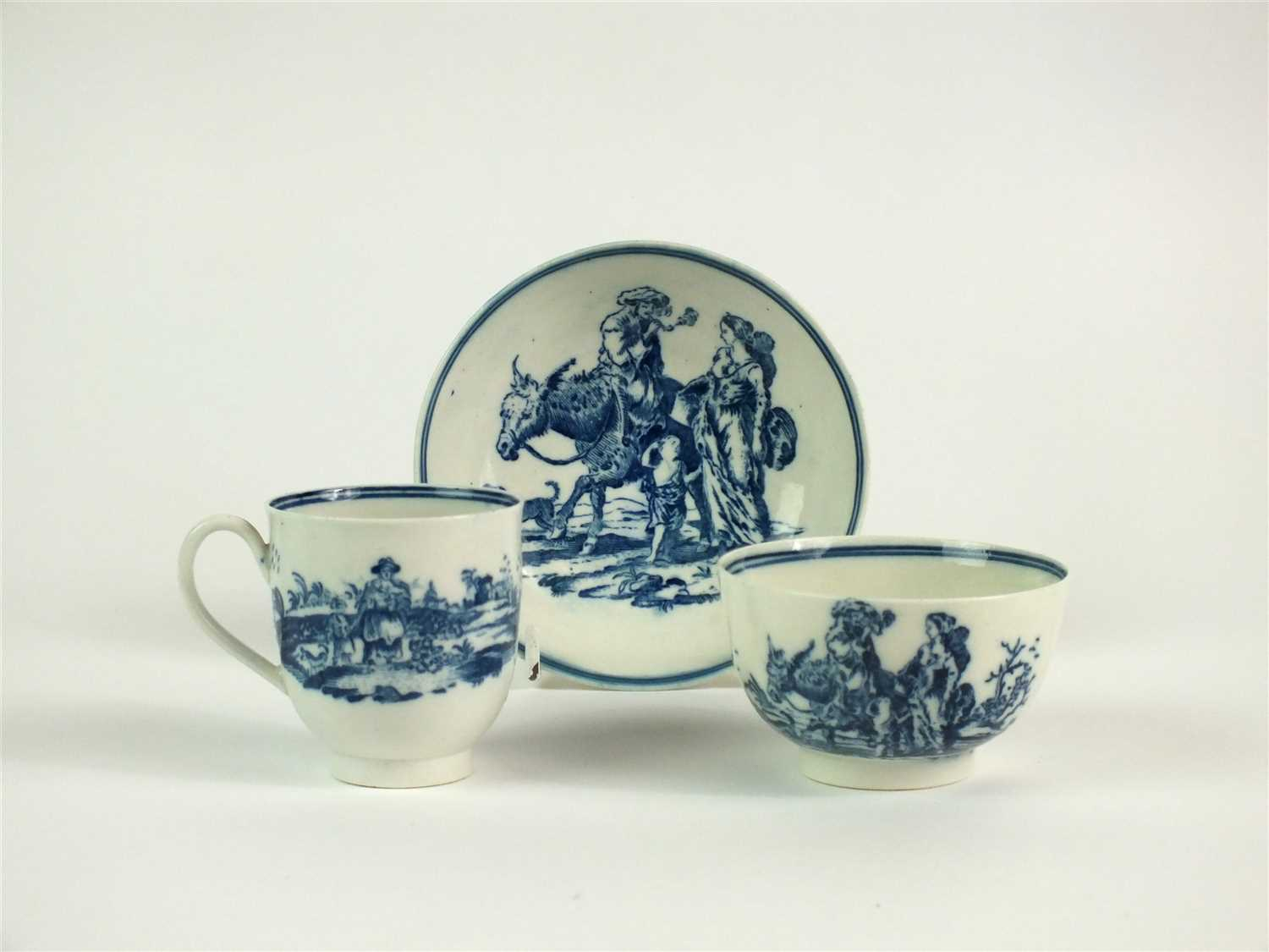 6 - A rare Caughley 'Travellers' trio of coffee cup, tea bowl and saucer