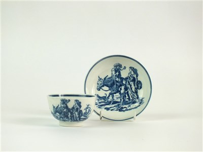 Lot 7-A rare Caughley 'Travellers' tea bowl and saucer
