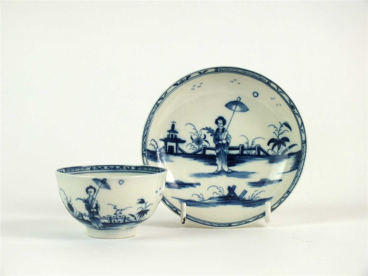 Lot 13-A Caughley porcelain 'Girl with Parasol' tea bowl and saucer
