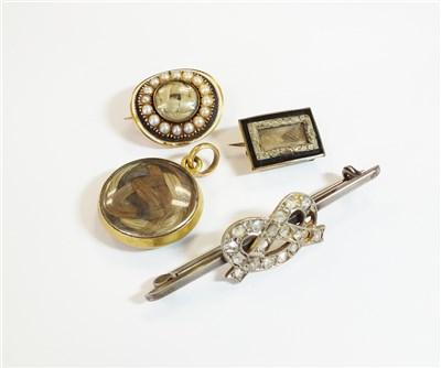 Lot 36-Three brooches and a locket