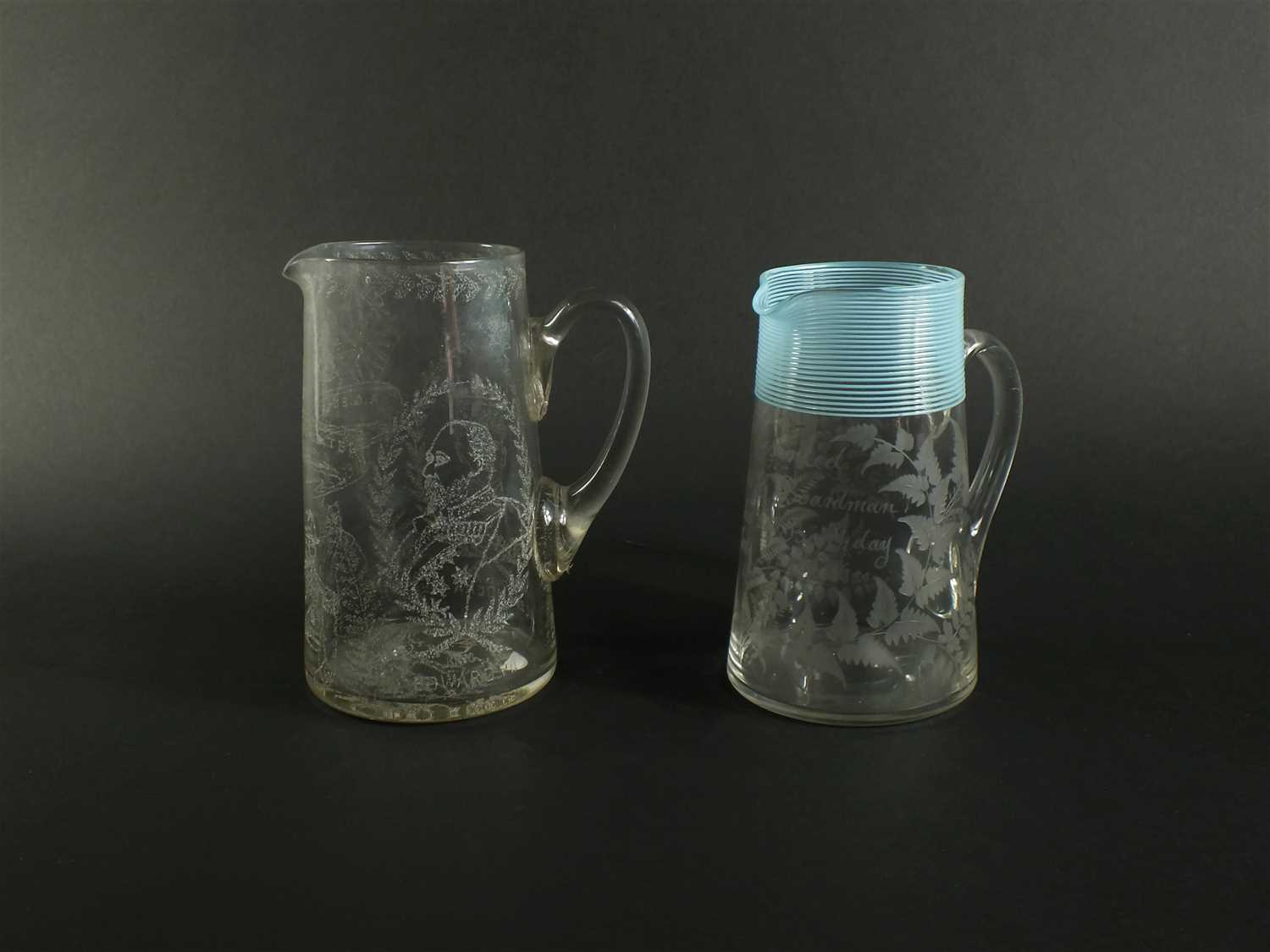 Lot 115 - Two English glass water jugs