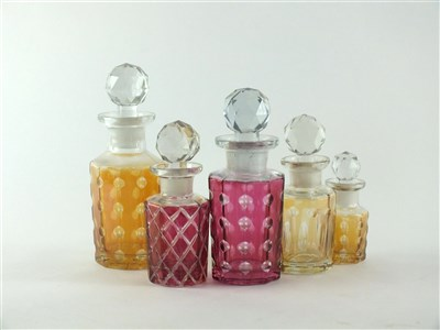Lot 134 - Five Baccarat glass perfume bottles and stoppers